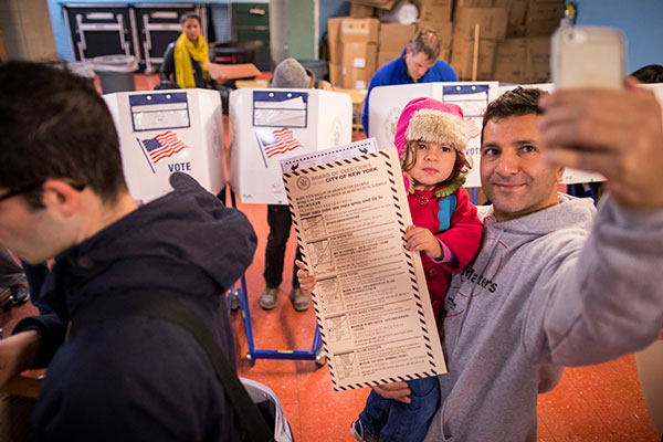 "<div class=""meta image-caption""><div class=""origin-logo origin-image none""><span>none</span></div><span class=""caption-text"">A man takes a selfie with his child as he waits to vote at a polling station in the Brooklyn borough of New York, Tuesday, Nov. 8, 2016. (Alexander F. Yuan/AP Photo)</span></div>"