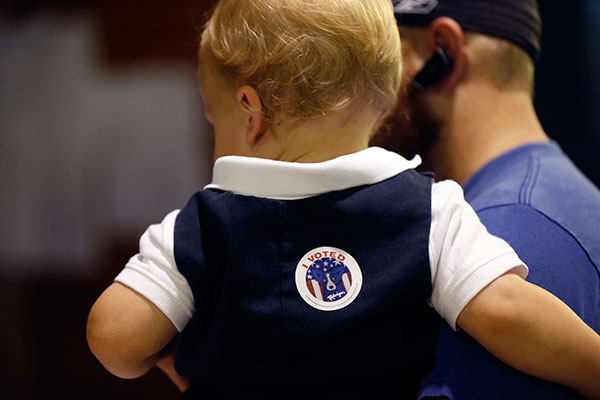 "<div class=""meta image-caption""><div class=""origin-logo origin-image none""><span>none</span></div><span class=""caption-text"">Ethan Deshotel, 19 months, sports an ""I voted"" sticker after his father A.J. Deshotel voted at St. Dominic's School in the Lakeview section of New Orleans on Tuesday. (Gerald Herbert/AP Photo)</span></div>"