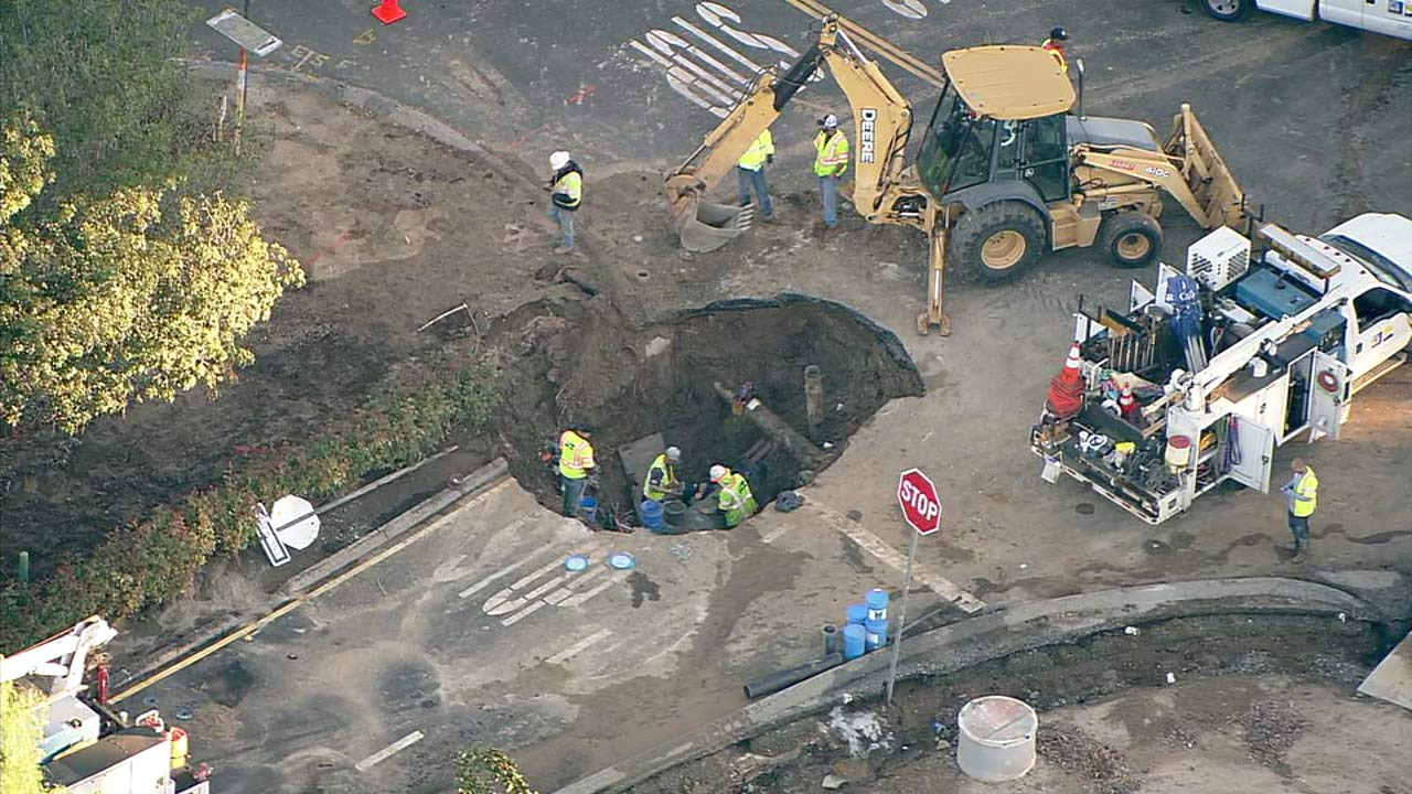 Crews work to repair a large sinkhole in Riverside on Tuesday, Nov. 8, 2016.
