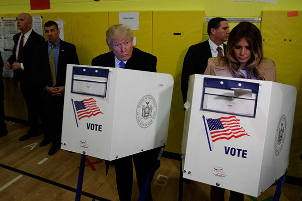 "<div class=""meta image-caption""><div class=""origin-logo origin-image none""><span>none</span></div><span class=""caption-text"">Republican presidential candidate Donald Trump and his wife Melania, casts their ballots at PS-59, Tuesday, Nov. 8, 2016, in New York. (Evan Vucci/AP Photo)</span></div>"