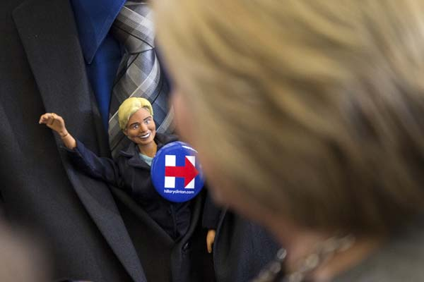 <div class='meta'><div class='origin-logo' data-origin='AP'></div><span class='caption-text' data-credit='AP Photo/Andrew Harnik'>A man tucks a doll, left, of Democratic presidential candidate Hillary Clinton into his suit jacket</span></div>