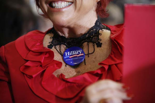 <div class='meta'><div class='origin-logo' data-origin='AP'></div><span class='caption-text' data-credit='AP Photo/John Locher'>A woman wears a button for Democratic presidential candidate Hillary Clinton</span></div>