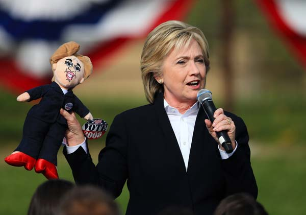 <div class='meta'><div class='origin-logo' data-origin='AP'></div><span class='caption-text' data-credit='AP Photo/Nati Harnik'>Democratic presidential candidate Hillary Rodham Clinton holds up a doll</span></div>