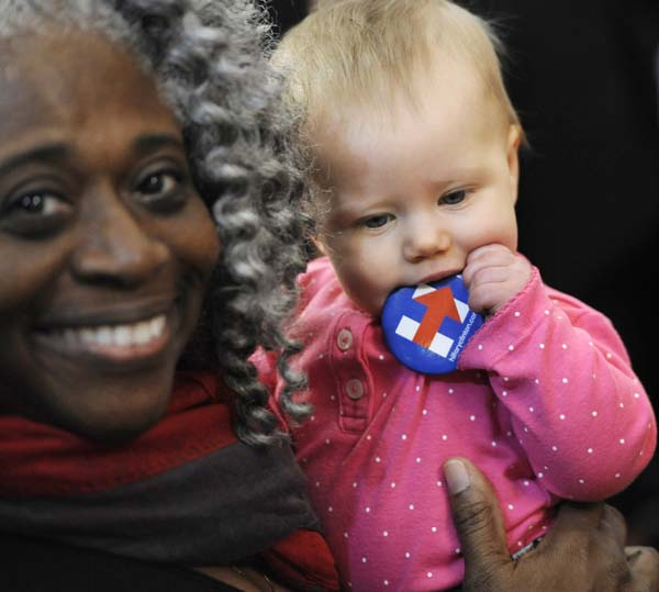 <div class='meta'><div class='origin-logo' data-origin='AP'></div><span class='caption-text' data-credit='AP Photo/Jessica Hill'>A baby teeths on a button for Democratic presidential candidate Hillary Clinton</span></div>