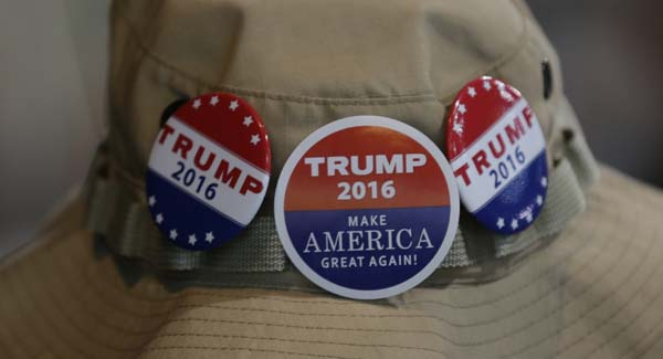 <div class='meta'><div class='origin-logo' data-origin='AP'></div><span class='caption-text' data-credit='AP Photo/Ted S. Warren'>A supporter of Republican presidential candidate Donald Trump wears buttons</span></div>