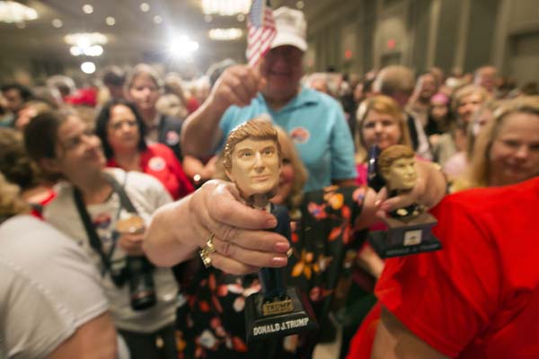 <div class='meta'><div class='origin-logo' data-origin='AP'></div><span class='caption-text' data-credit='AP Photo/Stephen B. Morton'>Supporters wave flags and bobble-head dolls while they wait for Republican presidential candidate Donald Trump</span></div>