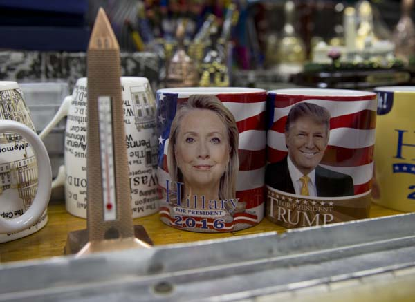 <div class='meta'><div class='origin-logo' data-origin='AP'></div><span class='caption-text' data-credit='AP Photo/Carolyn Kaster'>Coffee mugs for sale with the images of Democratic presidential candidate Hillary Clinton and Republican presidential candidate Donald Trump</span></div>