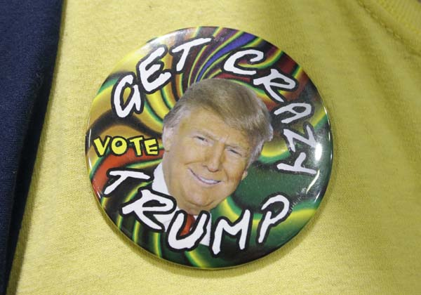 <div class='meta'><div class='origin-logo' data-origin='AP'></div><span class='caption-text' data-credit='AP Photo/Ted S. Warren'>A supporter of Republican presidential candidate Donald Trump wears a campaign button</span></div>