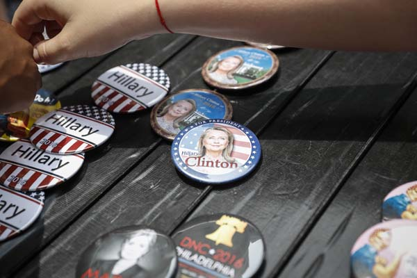 <div class='meta'><div class='origin-logo' data-origin='AP'></div><span class='caption-text' data-credit='AP Photo/John Minchillo'>Vendors sell campaign buttons in support of Democratic Presidential candidate Hillary Clinton</span></div>