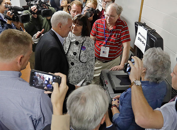 "<div class=""meta image-caption""><div class=""origin-logo origin-image none""><span>none</span></div><span class=""caption-text"">Republican vice presidential candidate, Indiana Gov. Mike Pence, with his wife Karen, casts his ballot, Tuesday, Nov. 8, 2016, in Indianapolis. (Darron Cummings/AP Photo)</span></div>"