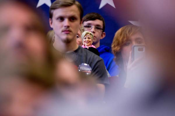 <div class='meta'><div class='origin-logo' data-origin='AP'></div><span class='caption-text' data-credit='AP Photo/Andrew Harnik'>A supporter in the audience holds up a Democratic presidential candidate Hillary Clinton doll</span></div>