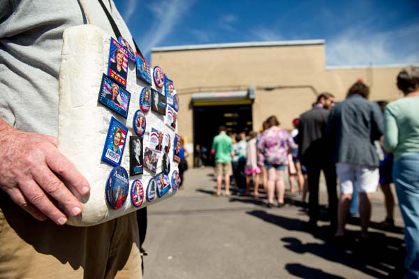 <div class='meta'><div class='origin-logo' data-origin='AP'></div><span class='caption-text' data-credit='AP Photo/Andrew Harnik'>A man sells buttons as guests line up to attend a rally for Democratic presidential candidate Hillary Clinton</span></div>