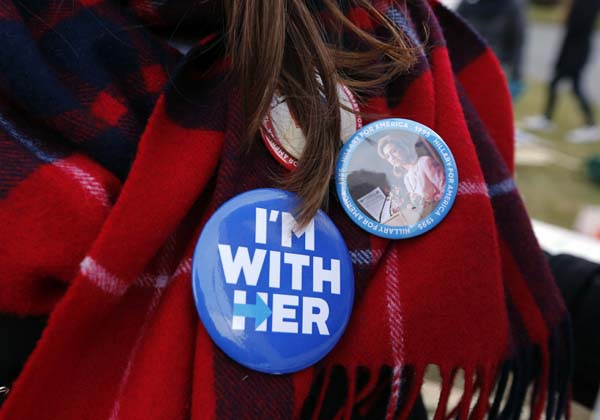 <div class='meta'><div class='origin-logo' data-origin='AP'></div><span class='caption-text' data-credit='AP Photo/Michael Dwyer'>A  Hillary Clinton supporter wears buttons</span></div>