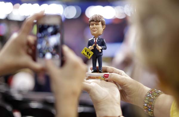 <div class='meta'><div class='origin-logo' data-origin='AP'></div><span class='caption-text' data-credit='AP Photo/Matt Rourke'>Delegates take pictures of a Donald Trump bubble-head doll</span></div>