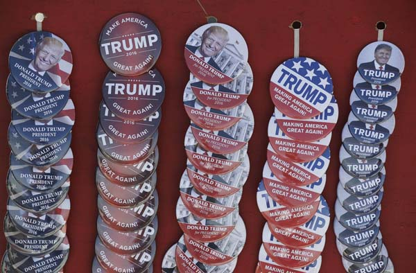 <div class='meta'><div class='origin-logo' data-origin='AP'></div><span class='caption-text' data-credit='AP Photo/Darron Cummings'>Buttons supporting Republican presidential candidate Donald Trump</span></div>