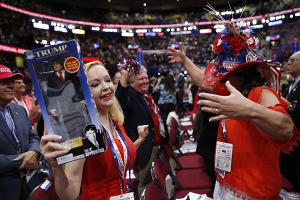 <div class='meta'><div class='origin-logo' data-origin='AP'></div><span class='caption-text' data-credit='AP Photo/Mary Altaffer'>Florida delegates Dana Dougherty, left, holding a Donald Trump doll</span></div>