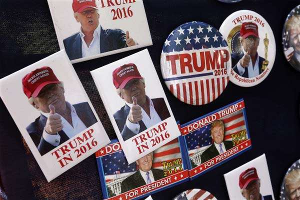 <div class='meta'><div class='origin-logo' data-origin='AP'></div><span class='caption-text' data-credit='AP Photo/Seth Perlman'>Campaign buttons for Republican presidential nominee Donald Trump</span></div>