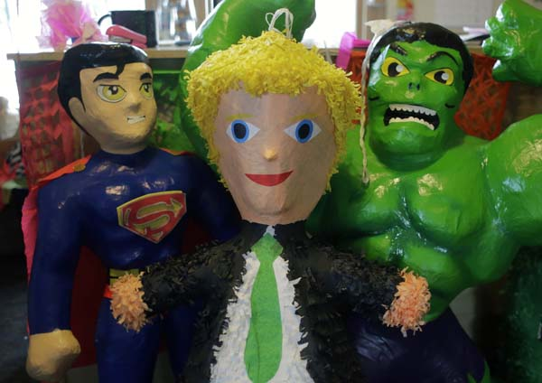 <div class='meta'><div class='origin-logo' data-origin='AP'></div><span class='caption-text' data-credit='AP Photo/Eric Gay'>A Donald Trump pinata stands with other paper mache figures at a shop, in San Antonio.</span></div>