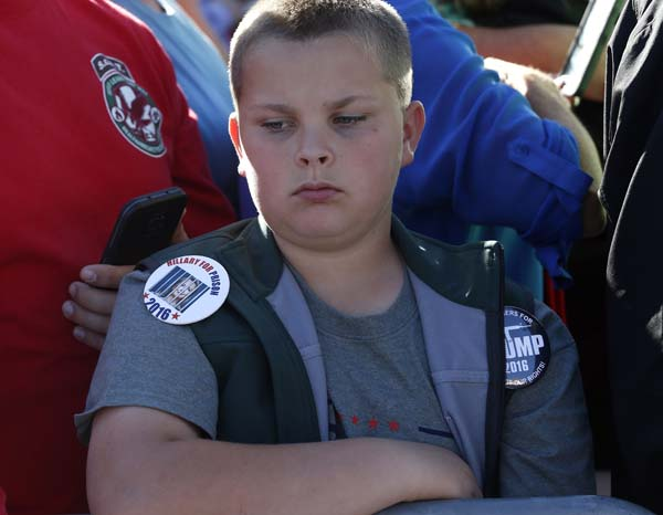 <div class='meta'><div class='origin-logo' data-origin='AP'></div><span class='caption-text' data-credit='AP Photo/ Brennan Linsley'>A boy wears the campaign buttons of Republican presidential candidate Donald Trump</span></div>
