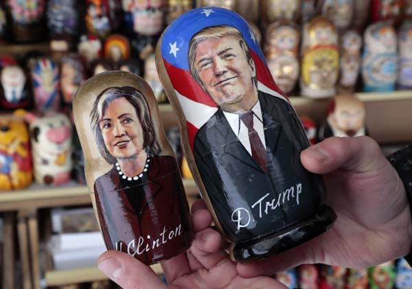 <div class='meta'><div class='origin-logo' data-origin='AP'></div><span class='caption-text' data-credit='AP Photo/Dmitri Lovetsky'>A customer holds traditional Russian wooden dolls depicting US presidential candidates Hillary Clinton and Donald Trump</span></div>