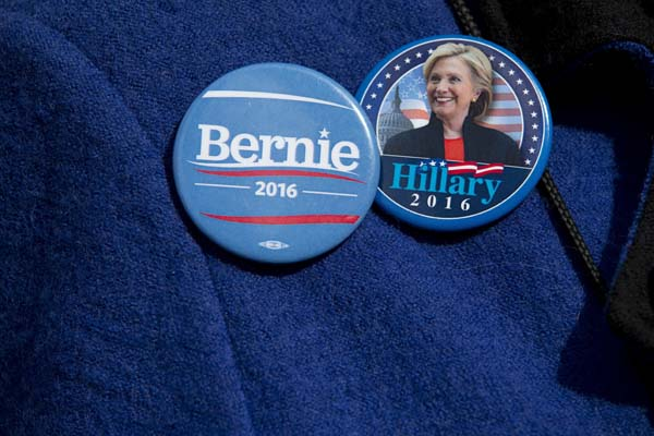 <div class='meta'><div class='origin-logo' data-origin='AP'></div><span class='caption-text' data-credit='AP Photo/Mary Altaffer'>A demonstrator wears Democratic presidential candidate's Sen. Bernie Sanders, I-Vt., and Hillary Clinton buttons during a rally</span></div>