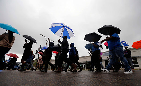 "<div class=""meta image-caption""><div class=""origin-logo origin-image none""><span>none</span></div><span class=""caption-text"">Dillard University students march in unison to a polling place to vote on election day in New Orleans, Tuesday, Nov. 8, 2016. (Gerald Herbert/AP Photo)</span></div>"