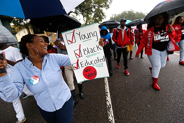 "<div class=""meta image-caption""><div class=""origin-logo origin-image none""><span>none</span></div><span class=""caption-text"">Mariah Hickman, a Dillard University student march in unison with fellow students, to a polling place to vote on election day in New Orleans, Tuesday, Nov. 8, 2016. (Gerald Herbert/AP Photo)</span></div>"