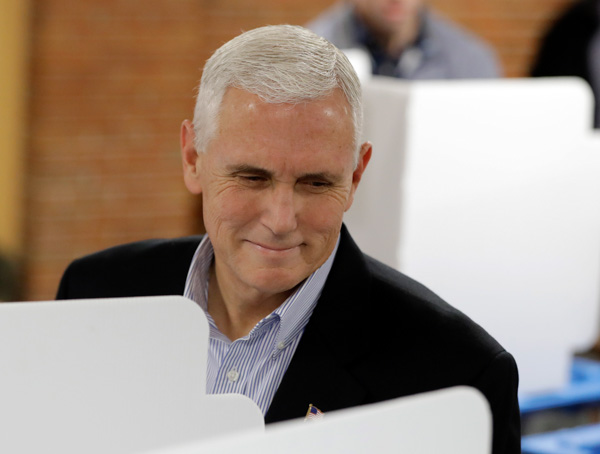 <div class='meta'><div class='origin-logo' data-origin='none'></div><span class='caption-text' data-credit='Darron Cummings/AP Images'>Republican vice presidential candidate, Indiana Gov. Mike Pence, smiles after casting his ballot, Tuesday, Nov. 8, 2016, in Indianapolis.</span></div>