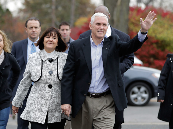 <div class='meta'><div class='origin-logo' data-origin='none'></div><span class='caption-text' data-credit='Darron Cummings/AP Images'>Republican vice presidential candidate, Indiana Gov. Mike Pence, accompanied by his wife, Karen, waves as they go to cast their ballots, Tuesday, Nov. 8, 2016, in Indianapolis.</span></div>