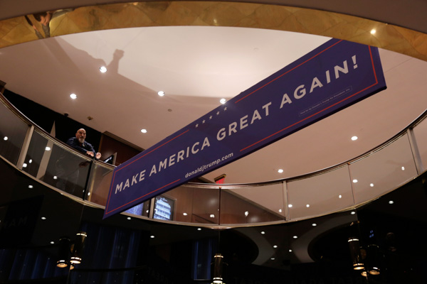 "<div class=""meta image-caption""><div class=""origin-logo origin-image none""><span>none</span></div><span class=""caption-text"">A worker places a sign as he prepares for Republican presidential candidate Donald Trump's election night rally, Tuesday, Nov. 8, 2016, in New York. (Julie Jacobson/AP Photo)</span></div>"