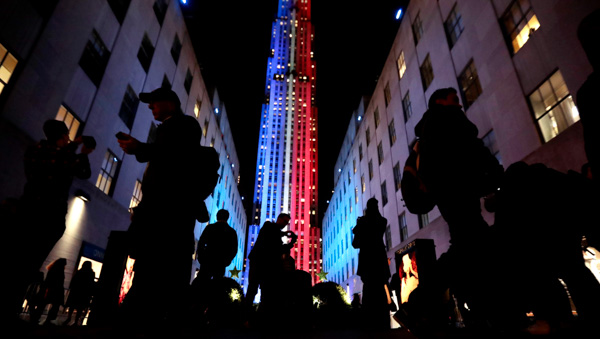 "<div class=""meta image-caption""><div class=""origin-logo origin-image none""><span>none</span></div><span class=""caption-text"">People stop for photographs in front of an Rockefeller Center, which is illuminated in patriotic lights during an Election Day gathering, Tuesday, Nov. 8, 2016, in New York. (Julio Cortez/AP Photo)</span></div>"