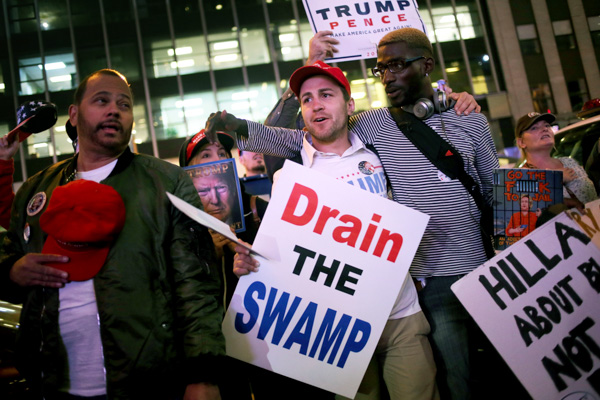 "<div class=""meta image-caption""><div class=""origin-logo origin-image none""><span>none</span></div><span class=""caption-text"">About a dozen supporters of Republican presidential candidate Donald Trump carry signs and sing as they walk through New York on Election Day, Tuesday, Nov. 8, 2016. (Seth Wenig/AP Photo)</span></div>"