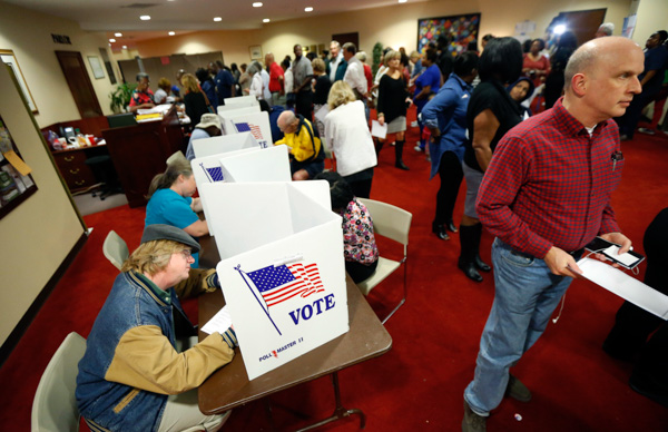 "<div class=""meta image-caption""><div class=""origin-logo origin-image none""><span>none</span></div><span class=""caption-text"">Last minute voters rush to cast their ballots on Election Day at the Christ United Methodist Church precinct in north Jackson, Miss., Tuesday, Nov. 8, 2016. (Rogelio V. Solis/AP Photo)</span></div>"