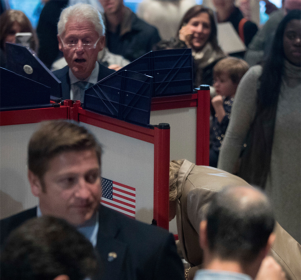 "<div class=""meta image-caption""><div class=""origin-logo origin-image ap""><span>AP</span></div><span class=""caption-text"">Former President Bill Clinton, top left, votes at Douglas G. Grafflin School in Chappaqua, N.Y., Tuesday, Nov. 8, 2016. (Andrew Harnik/AP)</span></div>"