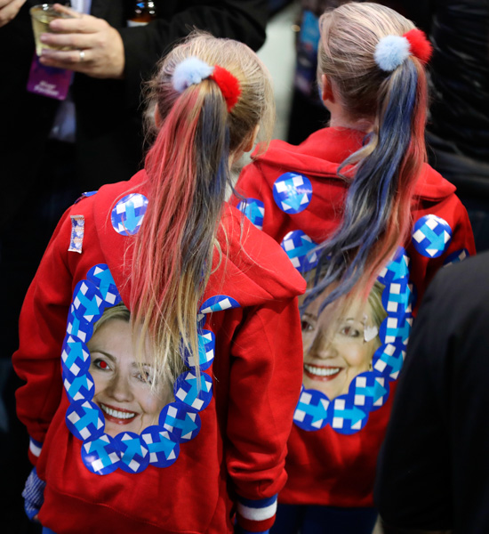 "<div class=""meta image-caption""><div class=""origin-logo origin-image none""><span>none</span></div><span class=""caption-text"">Girls wear jackets with the image of Hillary Clinton during Democratic presidential nominee's election night rally in the Jacob Javits Center glass enclosed lobby in New York. (David Goldman/AP Photo)</span></div>"