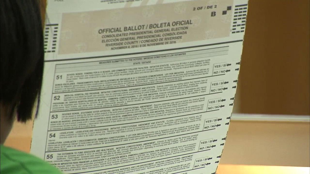 A California voter reviews her ballot on Tuesday, Nov. 8, 2016.