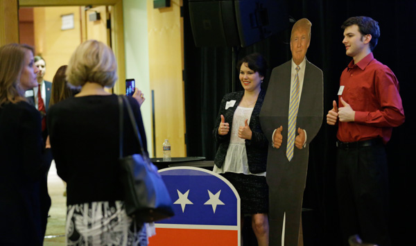 <div class='meta'><div class='origin-logo' data-origin='none'></div><span class='caption-text' data-credit='Ted S. Warren/AP Photo'>Washington state supporters of Donald Trump pose for a photo with a life-sized photo of Trump, Tuesday, Nov. 8, 2016, at a Republican gathering in Bellevue, Wash.</span></div>