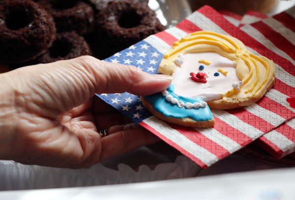 "<div class=""meta image-caption""><div class=""origin-logo origin-image none""><span>none</span></div><span class=""caption-text"">A guest picks up a cookie depicting Hillary Clinton prior to watch a live broadcasting of the 2016 U.S. Presidential Election results at U.S. Ambassador's residence in Tokyo. (Eugene Hoshiko/AP Photo)</span></div>"