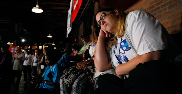 "<div class=""meta image-caption""><div class=""origin-logo origin-image none""><span>none</span></div><span class=""caption-text"">Stephanie Baile, intern for Democratic presidential candidate Hillary Clinton, watches the growing number of national votes for Republican Donald Trump on Tuesday, Nov. 8, 2016. (Rogelio V. Solis/AP Photo)</span></div>"