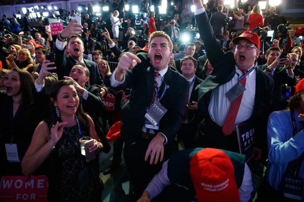 <div class='meta'><div class='origin-logo' data-origin='none'></div><span class='caption-text' data-credit='Evan Vucci/AP Photo'>Supporters of Republican presidential candidate Donald Trump cheer as they watch election returns during an election night rally, Tuesday, Nov. 8, 2016, in New York.</span></div>