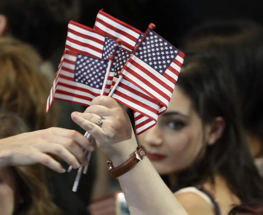 "<div class=""meta image-caption""><div class=""origin-logo origin-image ap""><span>AP</span></div><span class=""caption-text"">American flags are handed out during Democratic presidential nominee Hillary Clinton's election night rally in the Jacob Javits Center glass enclosed lobby in New York. (AP Photo/David Goldman)</span></div>"