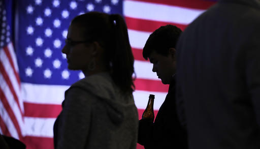 """<div class=""""meta image-caption""""><div class=""""origin-logo origin-image ap""""><span>AP</span></div><span class=""""caption-text"""">Connor Stubbs of Decatur, Ga., holds a beer as he looks down at his cell phone while monitoring election returns during an election night rally in Manchester, N.H. (AP Photo/Charles Krupa)</span></div>"""