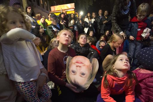 "<div class=""meta image-caption""><div class=""origin-logo origin-image ap""><span>AP</span></div><span class=""caption-text"">A boy holds a photo of Democratic presidential candidate Hillary Clinton during an election night block party in the Carroll Gardens neighborhood in Brooklyn, New York. (AP Photo/Mark Lennihan)</span></div>"