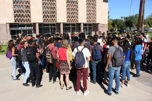 <div class='meta'><div class='origin-logo' data-origin='none'></div><span class='caption-text' data-credit='AP Photo/Bob Christie'>Arizona Department of Public Safety Capt. Ed Sharpensteen, center, speaks to high school students protesting Donald Trump's election at the state Capitol in Phoenix.</span></div>