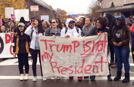 <div class='meta'><div class='origin-logo' data-origin='AP'></div><span class='caption-text' data-credit='AP Photo/Pat Eaton-Robb'>People protest on the University of Connecticut campus against the election of Republican Donald Trump as President Wednesday, Nov. 9, 2016, in Storrs, Conn.</span></div>