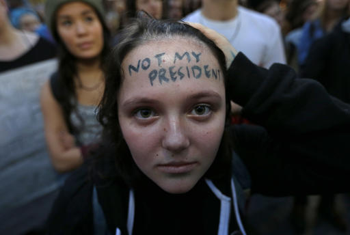 <div class='meta'><div class='origin-logo' data-origin='none'></div><span class='caption-text' data-credit='AP Photo/Ted S. Warren'>Clair Sheehan has the words &#34;Not My President&#34; written on her forehead as she takes part in a protest against the election of President-elect Donald Trump in downtown Seattle.</span></div>