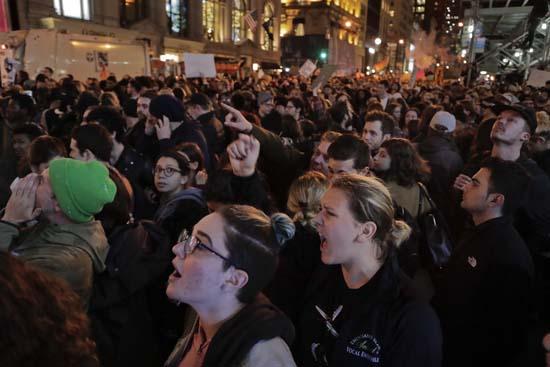 <div class='meta'><div class='origin-logo' data-origin='AP'></div><span class='caption-text' data-credit='Julie Jacobson'>Protesters chant slogans on Fifth Avenue outside Trump Tower, Wednesday, Nov. 9, 2016, in New York.</span></div>
