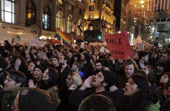 <div class='meta'><div class='origin-logo' data-origin='AP'></div><span class='caption-text' data-credit='Julie Jacobson'>Protesters chant slogans on Fifth Avenue outside Trump Tower, Wednesday, Nov. 9, 2016, in New York, in opposition of Donald Trump's presidential election victory.</span></div>