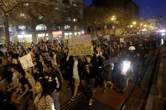 <div class='meta'><div class='origin-logo' data-origin='AP'></div><span class='caption-text' data-credit='AP'>Protesters march in opposition of Donald Trump's presidential election victory in San Francisco, Wednesday, Nov. 9, 2016. (AP Photo/Jeff Chiu)</span></div>