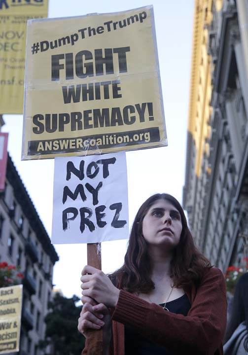 <div class='meta'><div class='origin-logo' data-origin='AP'></div><span class='caption-text' data-credit='AP'>Protester Ciera Eis holds up signs in opposition of Donald Trump's presidential election victory in San Francisco, Wednesday, Nov. 9, 2016. (AP Photo/Jeff Chiu)</span></div>